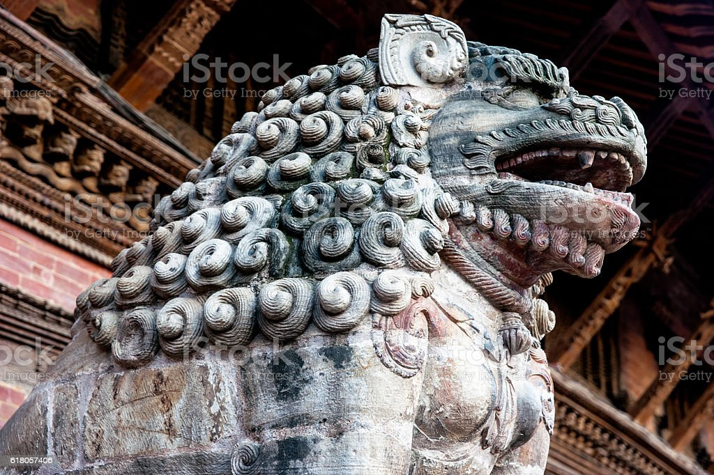 Stone guardian lion in Patan, Nepal stock photo