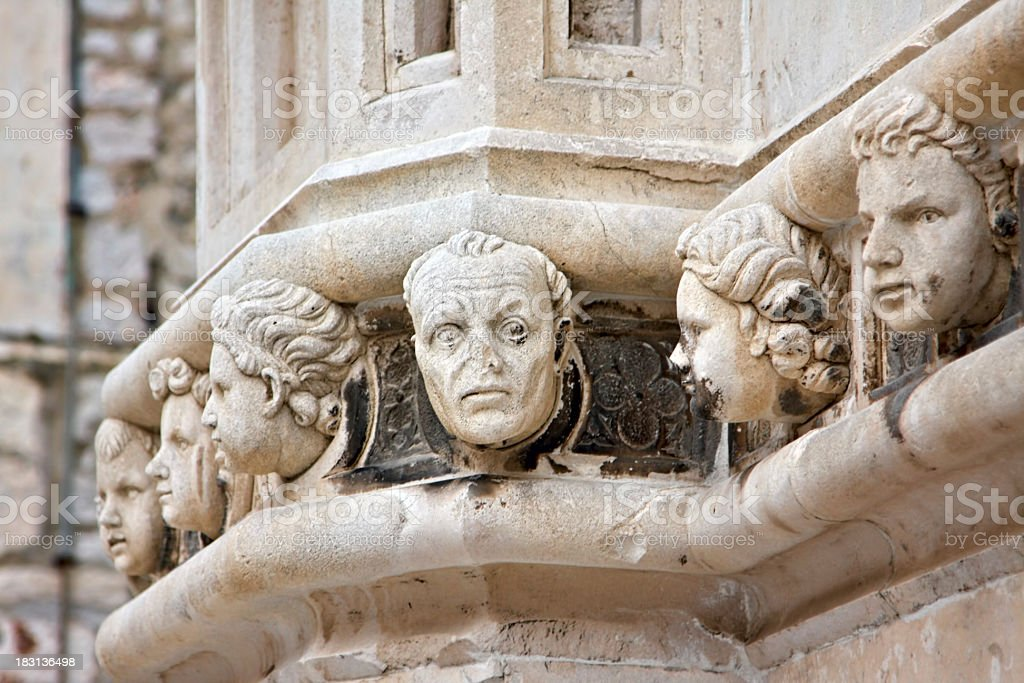 Stone heads at Cathedral of St James in Sibenik stock photo