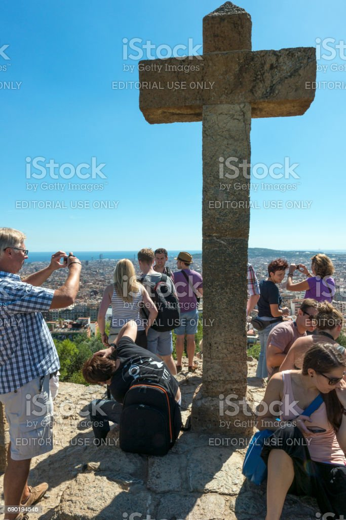 Stone hill crowned with cross stock photo