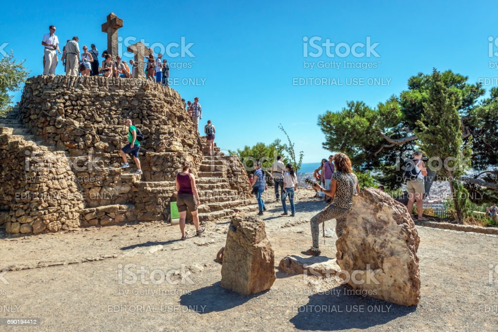 Stone hill crowned with three crosses stock photo
