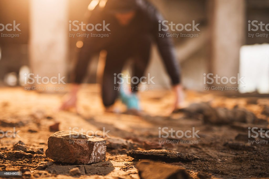 Stone in a ruin with an athlete in the background. stock photo
