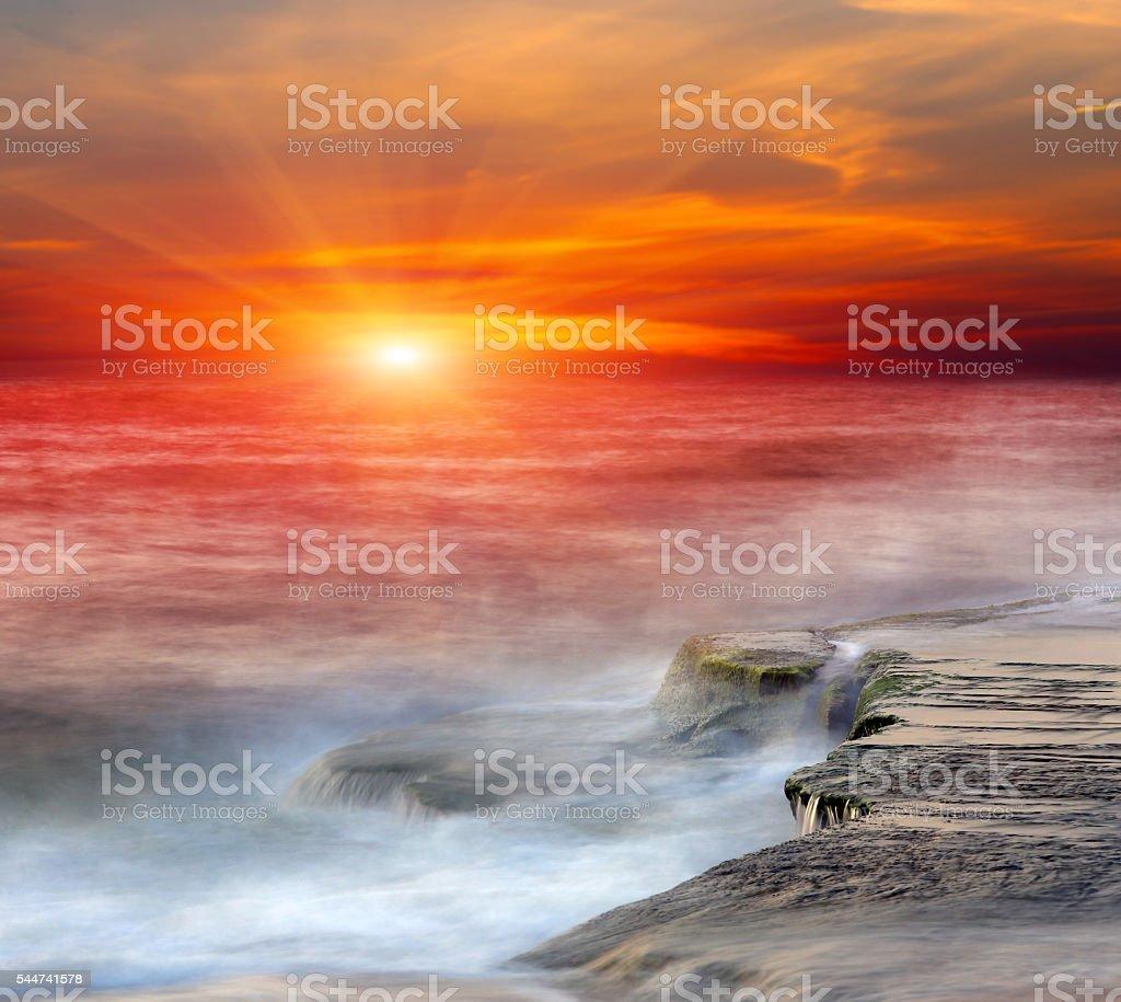 Stone in sea water stock photo