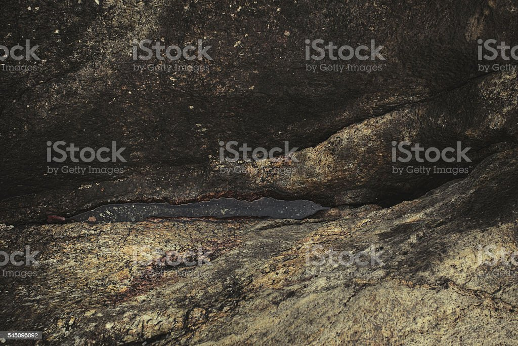 stone in the form of vulva stock photo