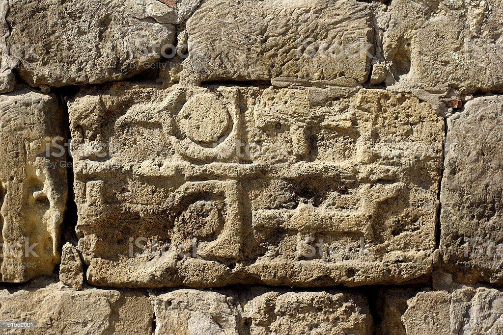 stone inscription and symbols royalty-free stock photo
