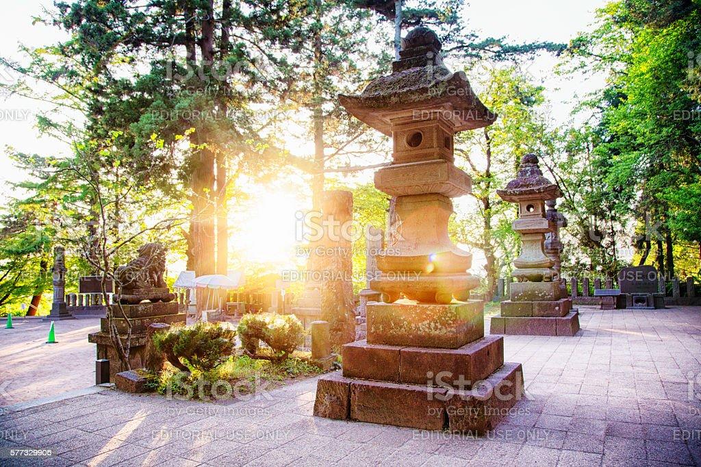 Stone lanterns at the Byakkotai memorial site in Aizuwakamatsu Japan stock photo