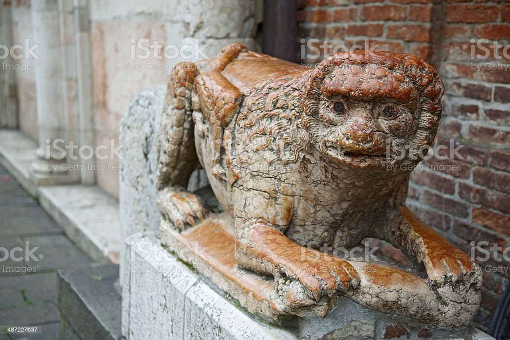 Stone lion statue in front of Ferrara Cathedral entrance stock photo