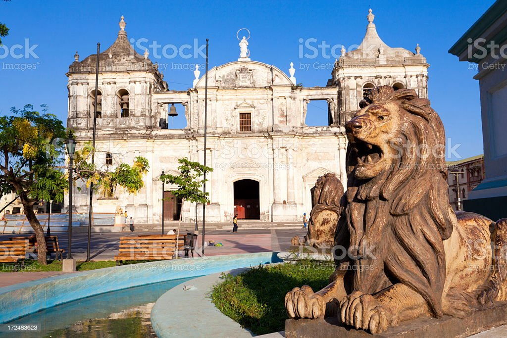 Stone lions in front of Catedral de Lee_n in Nicaragua stock photo