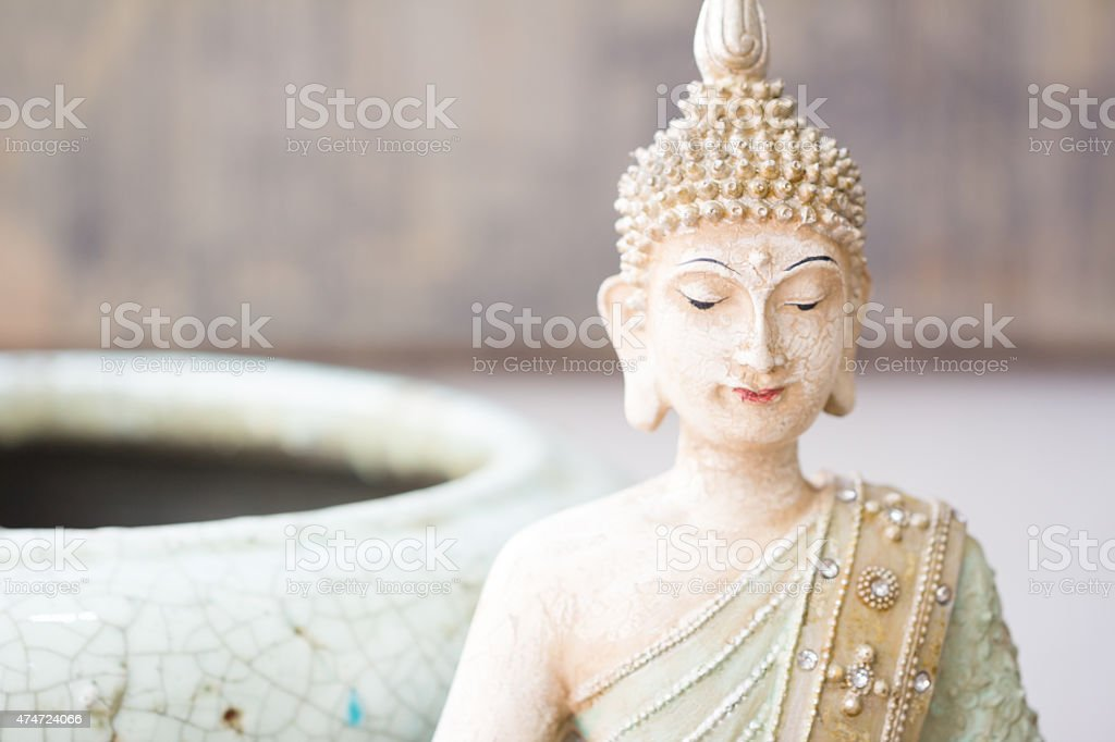 stone made buddha in pastel colors stock photo