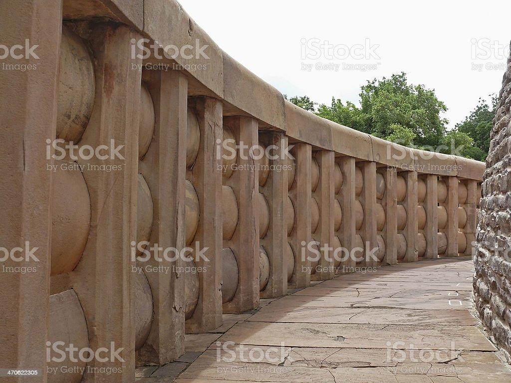 Stone made compound wall around Sanchi stupa one stock photo