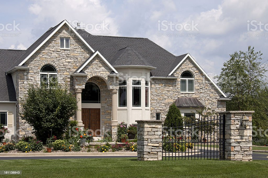 Stone mansion with gate royalty-free stock photo