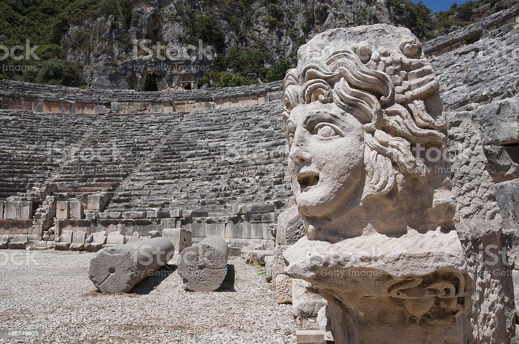 Stone mask and ancient amphitheater, Myra (Turkey) stock photo