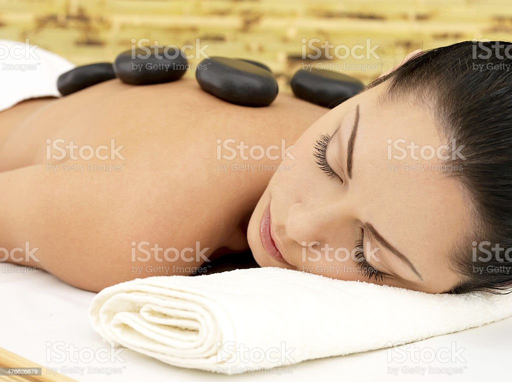 Stone massage for woman at  spa salon. royalty-free stock photo