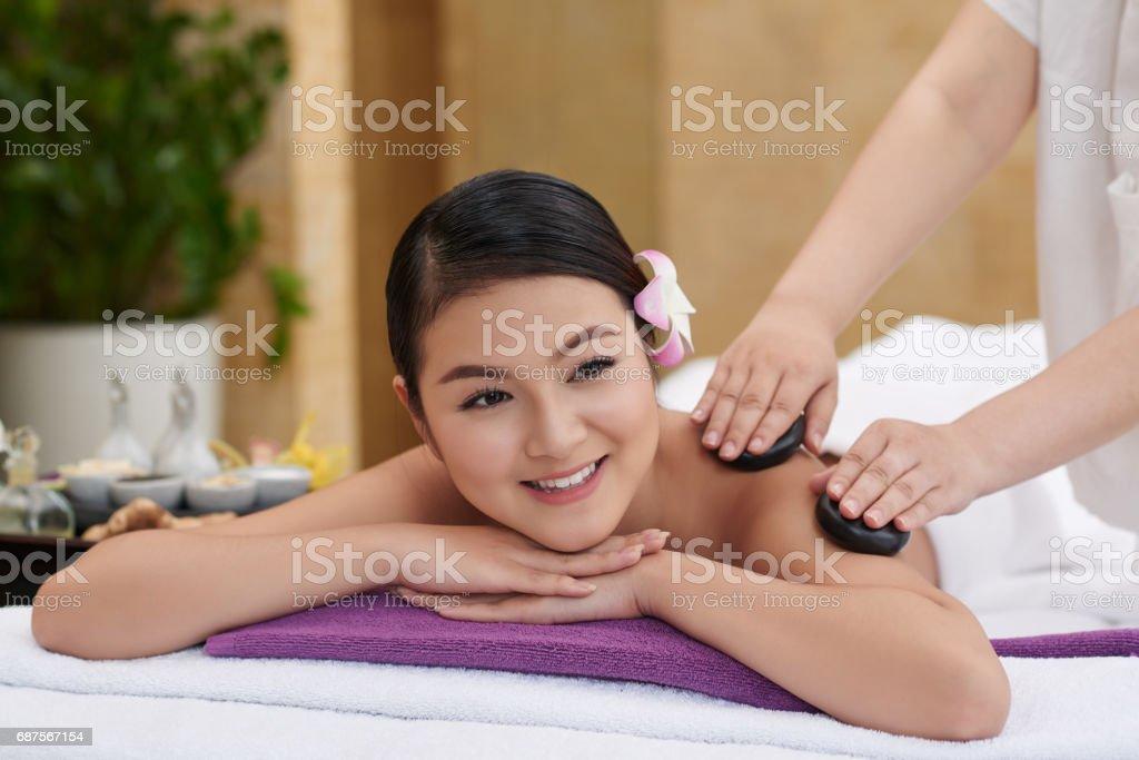 Stone Massage in Beauty Salon stock photo