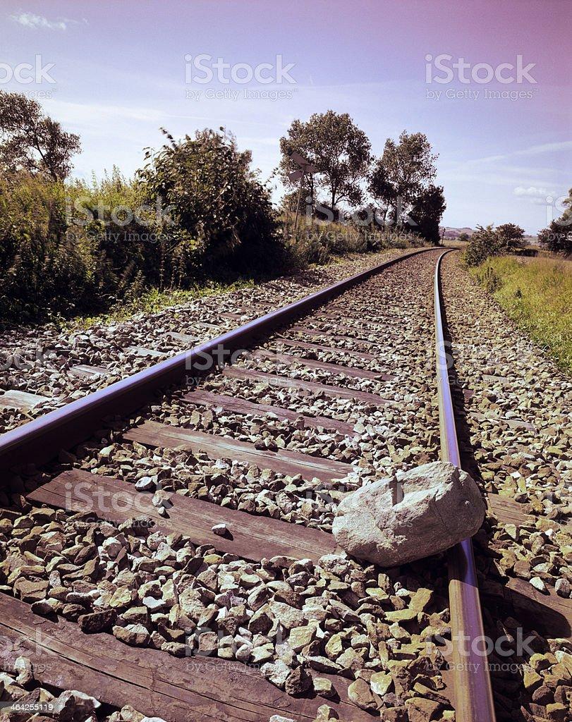 Stone on rail stock photo