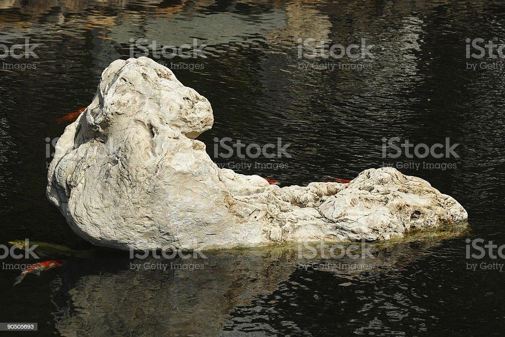 Stone on the lake stock photo