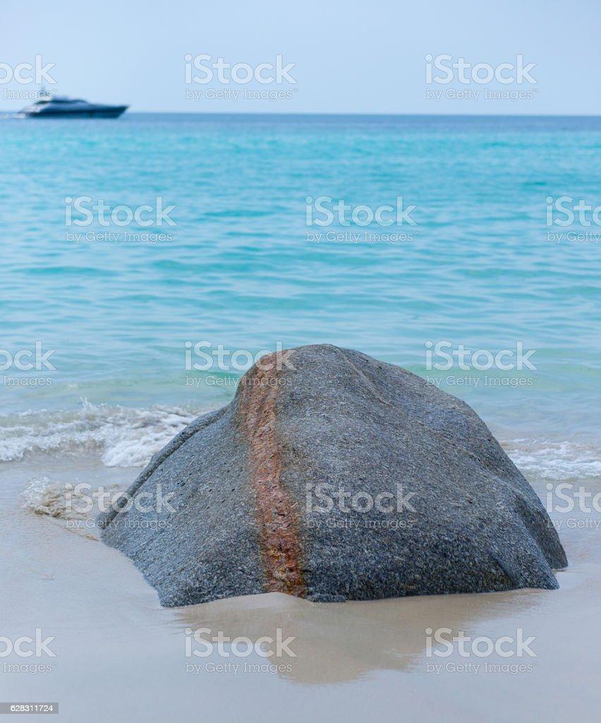 Stone on the sand stock photo
