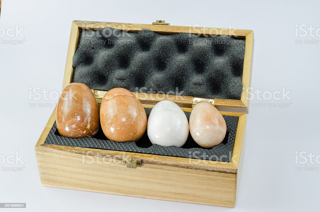 Stone oval open wooden box isolated stock photo
