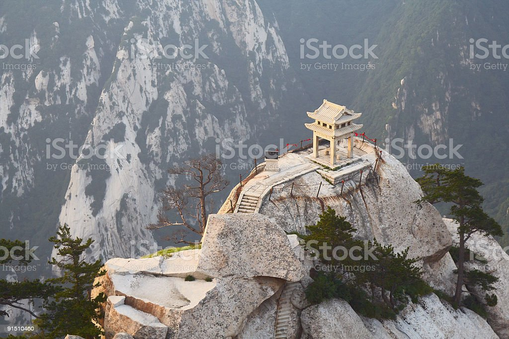 A stone pagoda with mountains in the background royalty-free stock photo