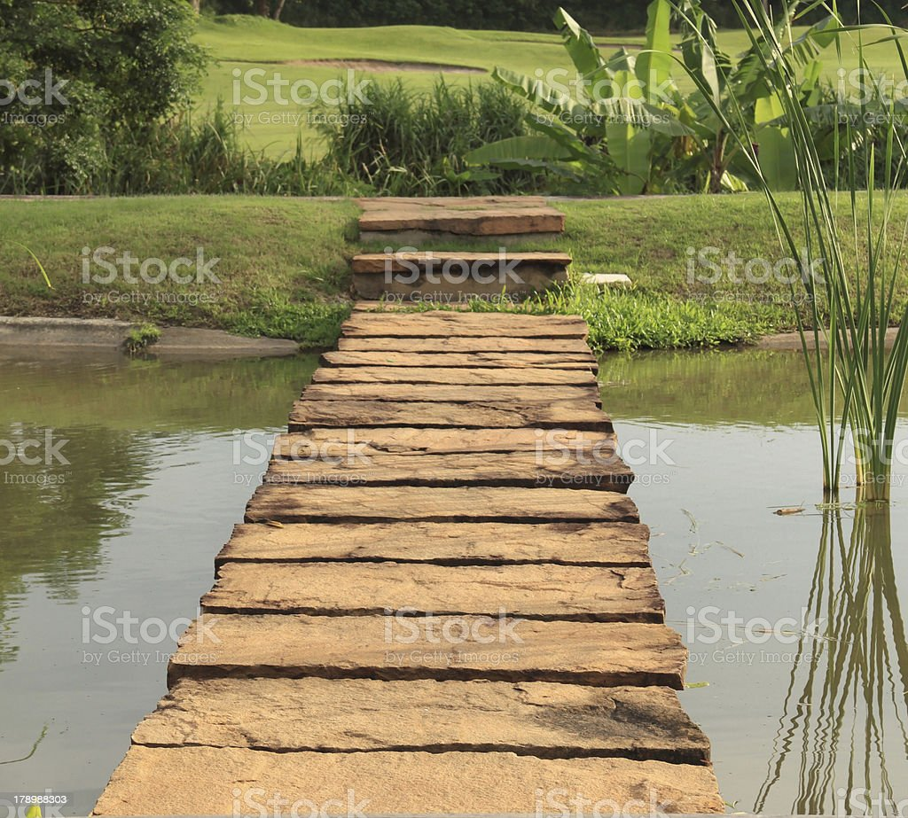 Stone path across pond royalty-free stock photo