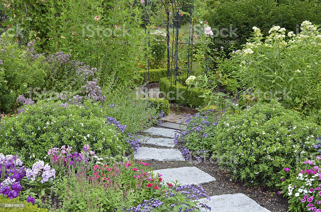 Stone path in garden stock photo