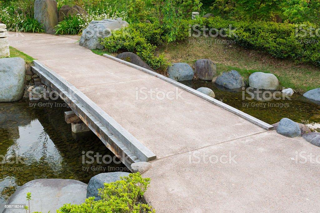 Stone path in Garden, stone bridge, across a pond. stock photo