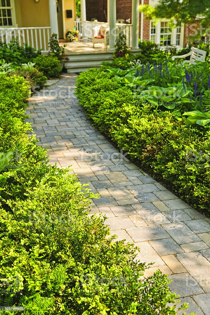 Stone path in landscaped home garden stock photo