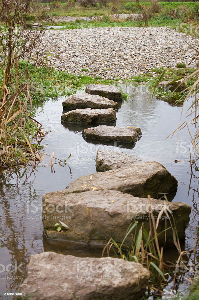 Stone path over a small stream in Germany stock photo
