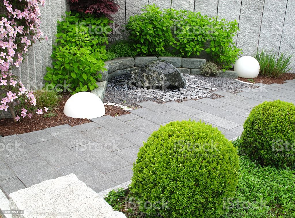 A stone pathway through a garden stock photo