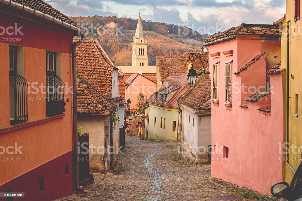 Stone paved old streets with colorful houses in Sighisoara stock photo