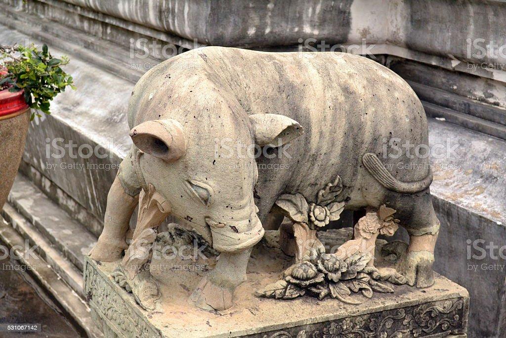 Stone pig stock photo
