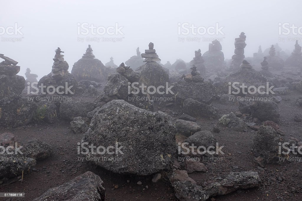 Stone piramids in fog, Kilimanjaro stock photo