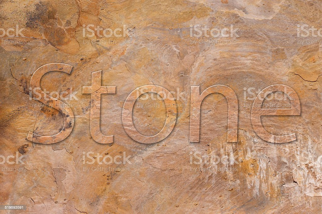 Stone plate with a font in relief royalty-free stock photo