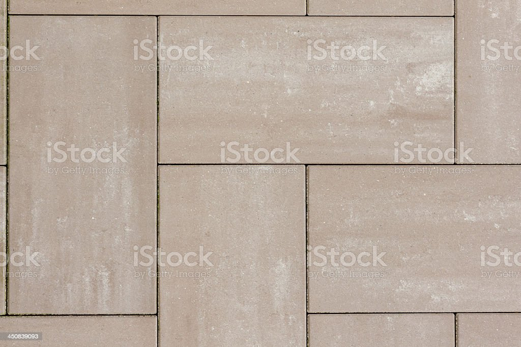 Stone plates in brown on a sideway with seams stock photo