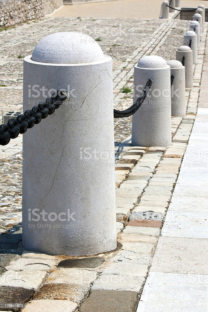 stone post fence in perspective royalty-free stock photo