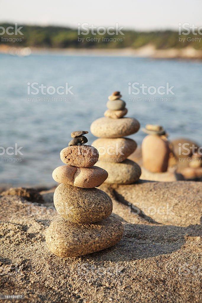 stone pyramid on the beach royalty-free stock photo