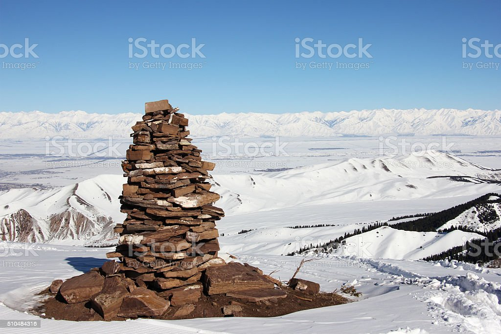 stone pyramid on the top of mountain, Issyk Kul lake stock photo