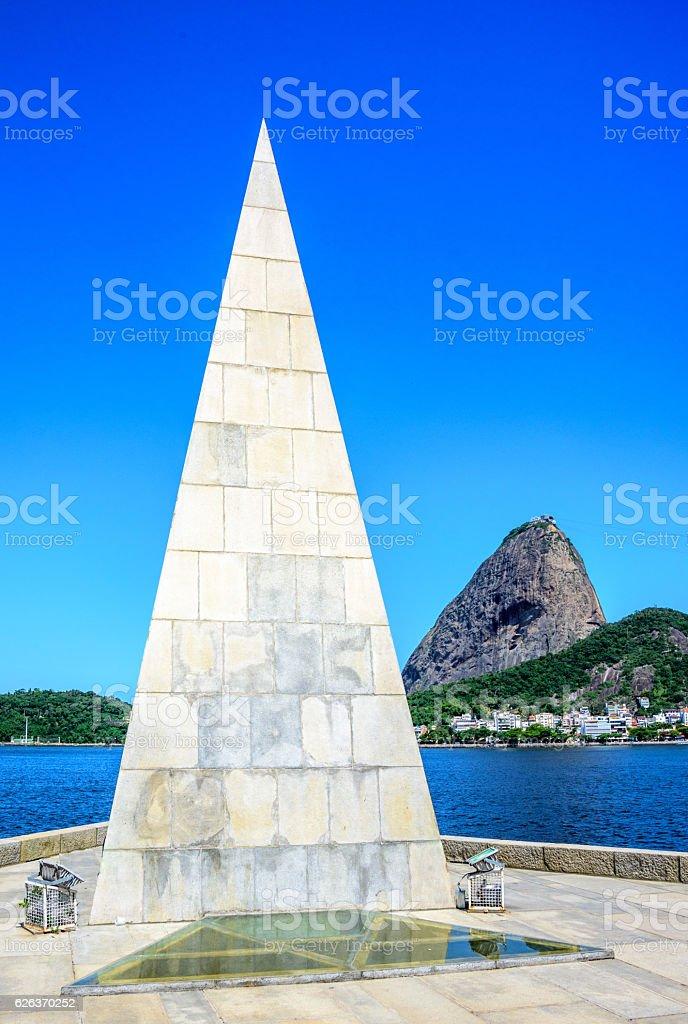 Stone pyramid-shaped needle rising from the ground, Estacio de Sa stock photo