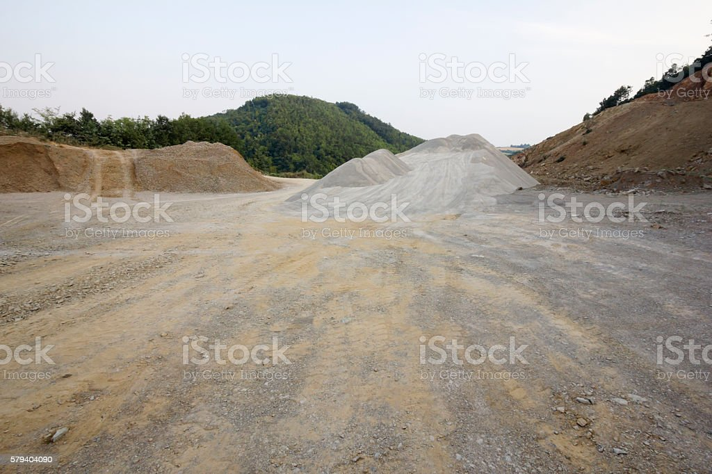 Stone quarry with pile of gravel stock photo