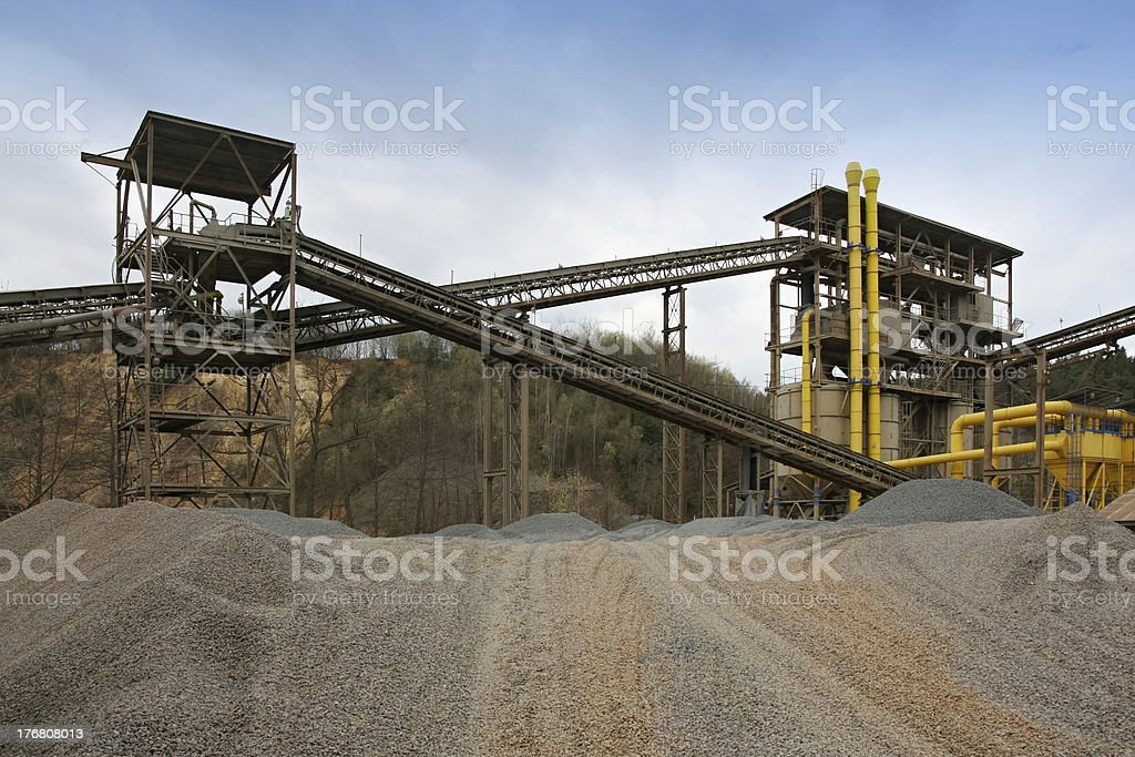 Stone quarry with silos, conveyor belts and piles of stones. royalty-free stock photo