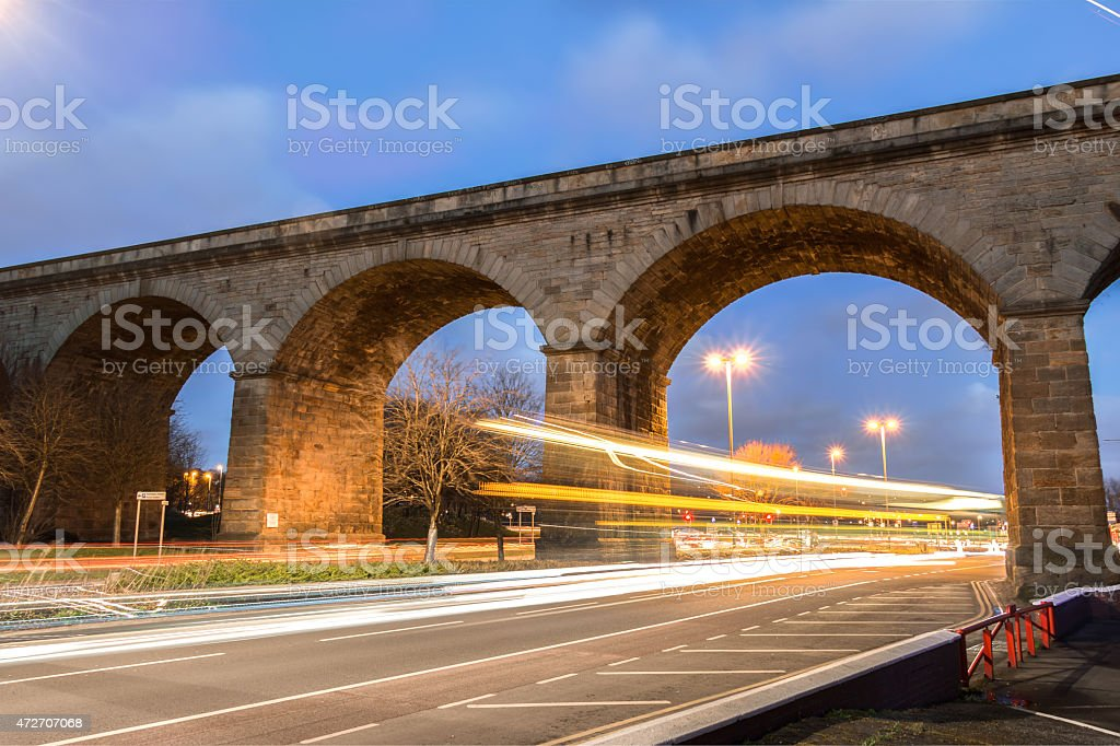 Stone Railway Bridge with Light Trail stock photo