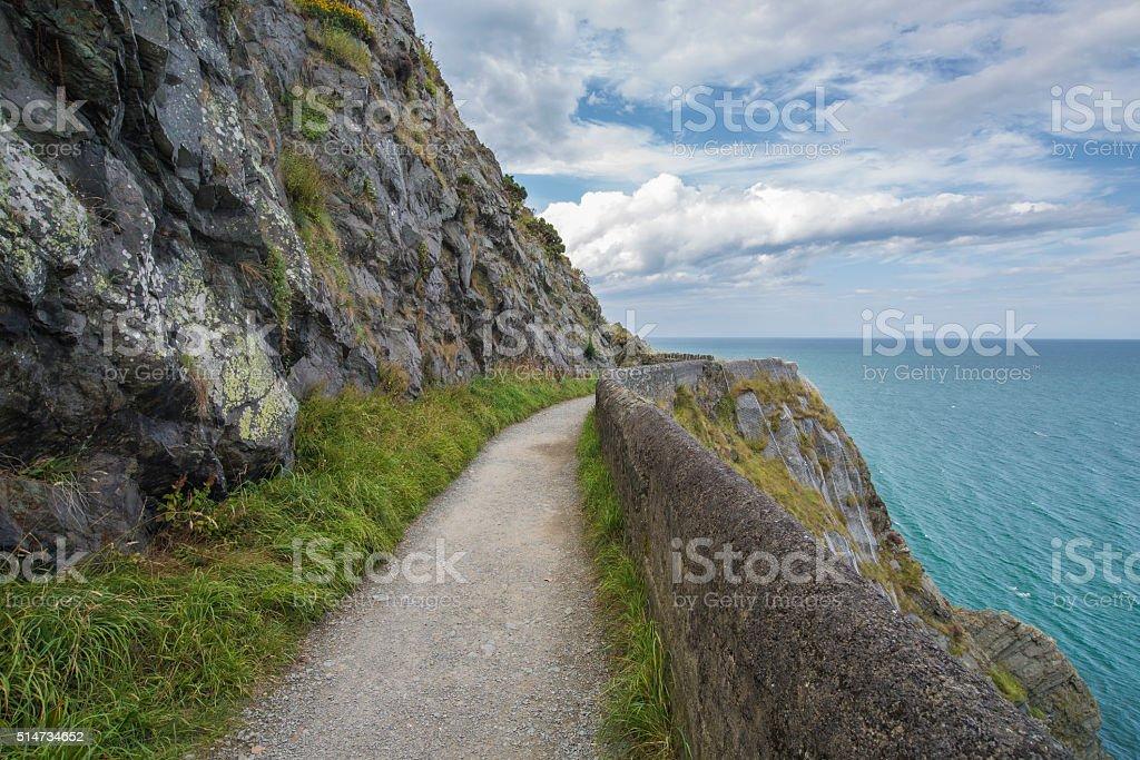 Stone rocks mountain path at Irish seacoast. Bray, Greystone stock photo