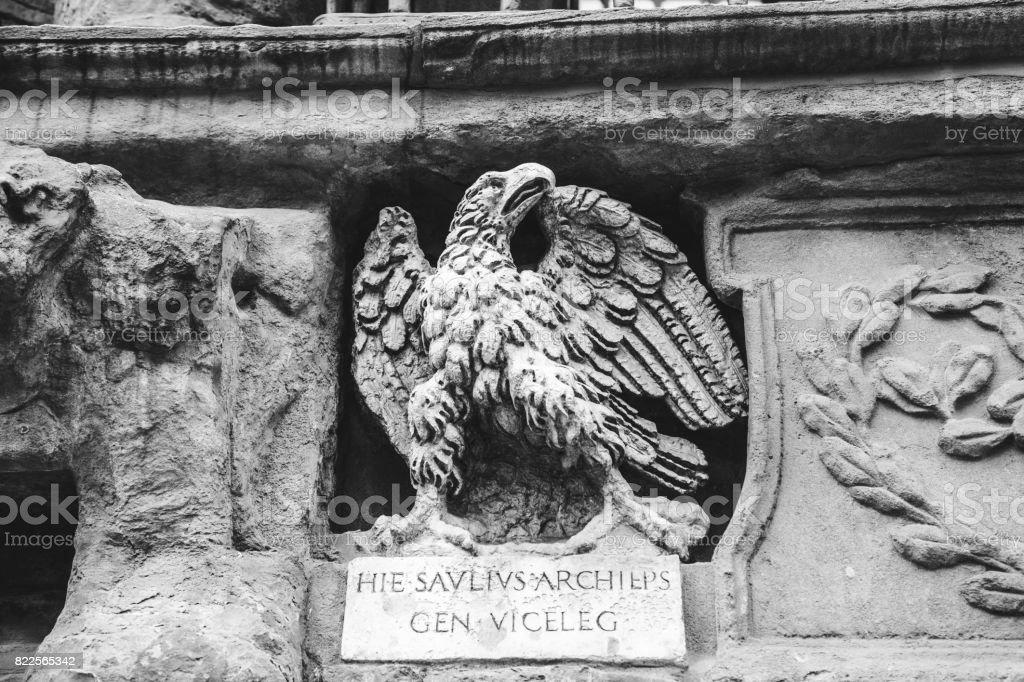 Stone roman eagle in Bologna, Italy stock photo