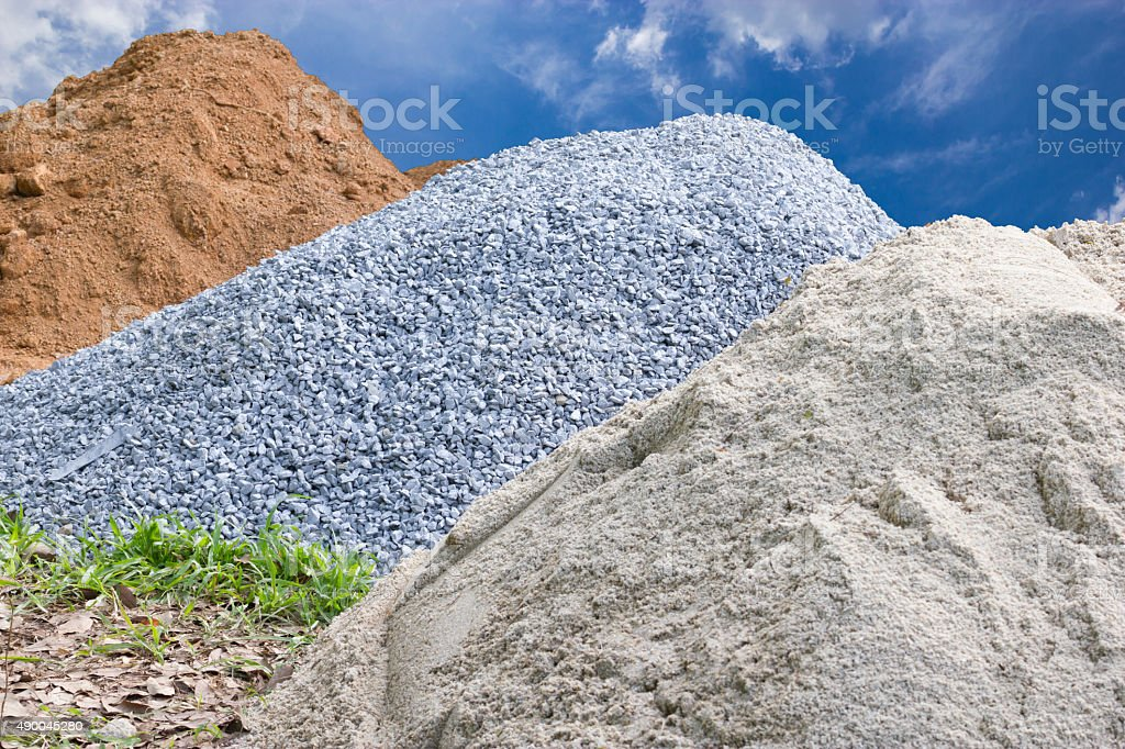 Stone, sand and mounds for construction stock photo