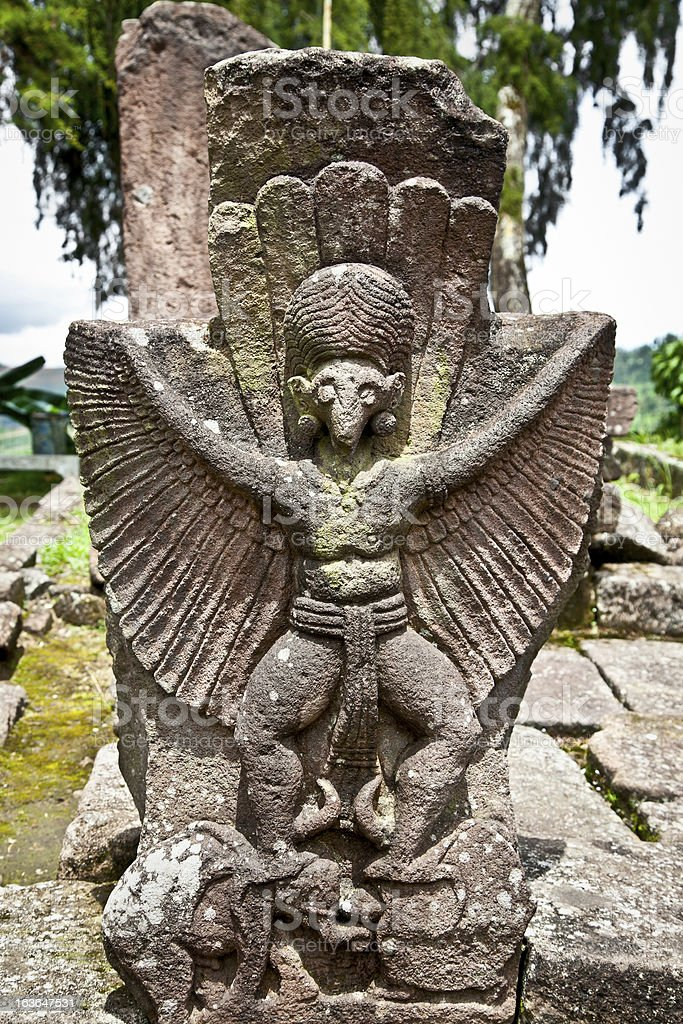 Stone sculpture in ancient Candi Sukuh on  Java, Indonesia royalty-free stock photo