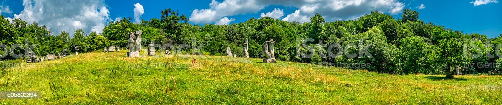 Stone sculptures field stock photo