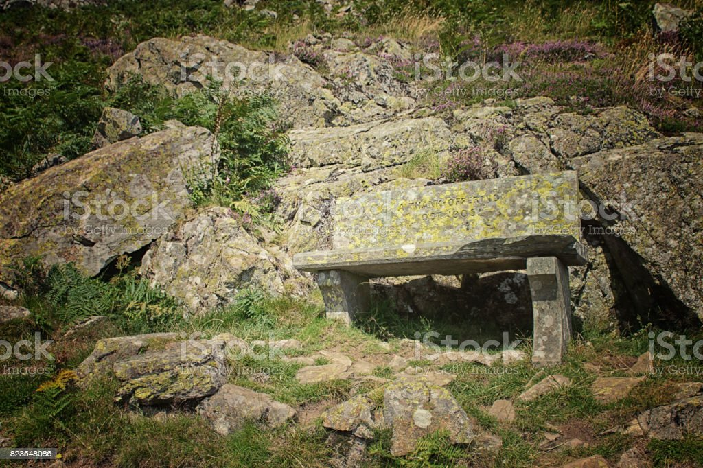 Stone seat on the banks of Ullswater stock photo