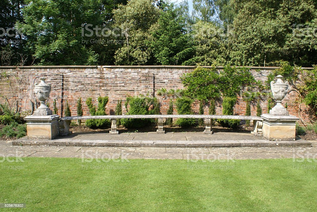 Stone seat with lidded urns stock photo