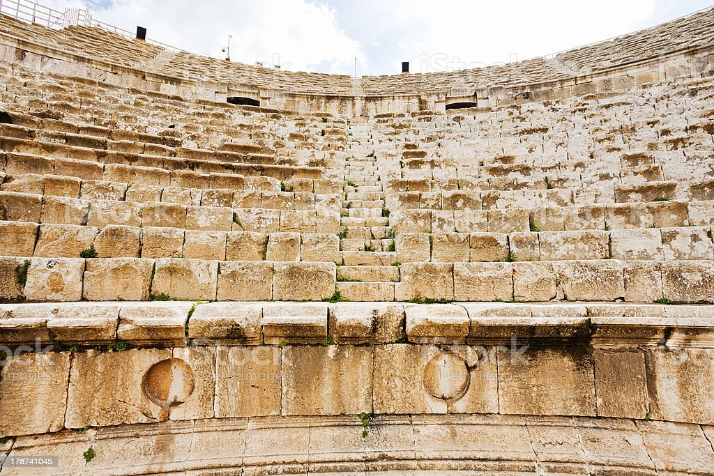 stone seats in antique Large South Theatre , Jerash stock photo