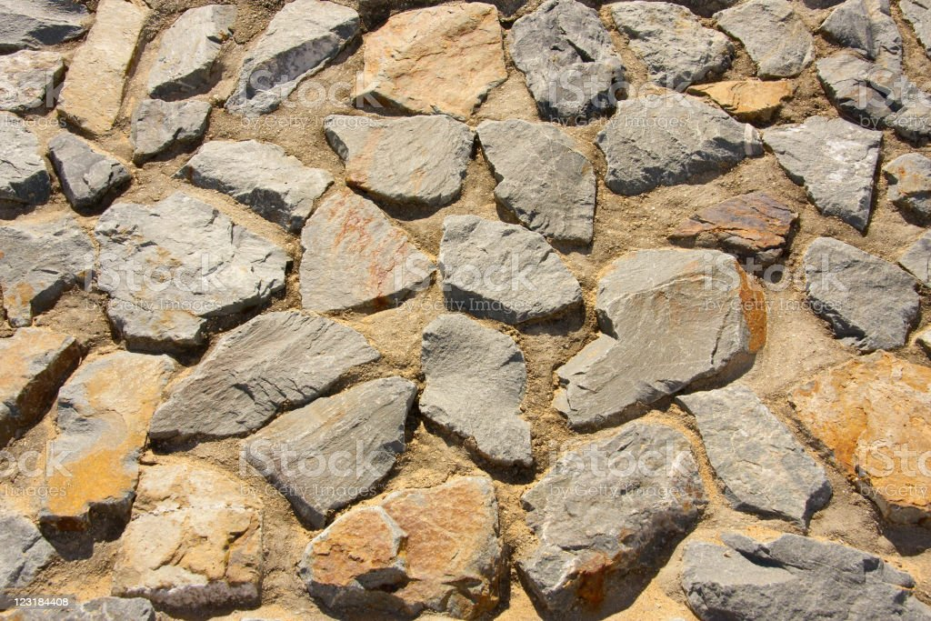 Stone set in cement to create a decorative wall stock photo