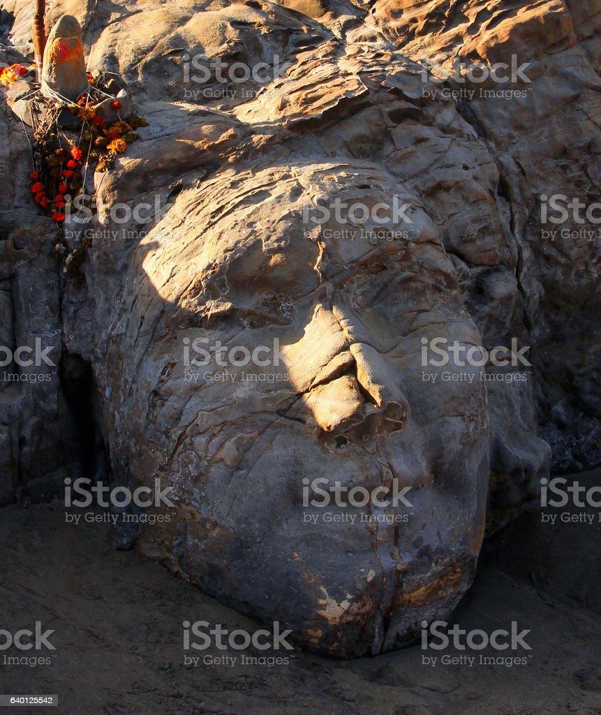 stone Shiva face on Vagator beach of Goa, India stock photo